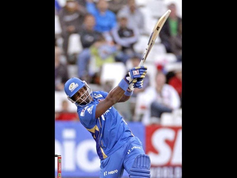 Mumbai Indians Dwayne Smith, right, plays a shot against Yorkshire during the Champions League Twenty20 in Cape Town. AP Photo/Schalk van Zuydam