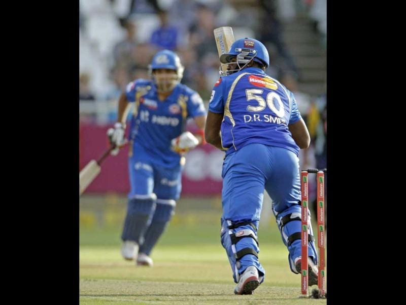 Mumbai Indians Dwayne Smith, right, makes a run against Yorkshire during the Champions League Twenty20 in Cape Town. AP Photo/Schalk van Zuydam