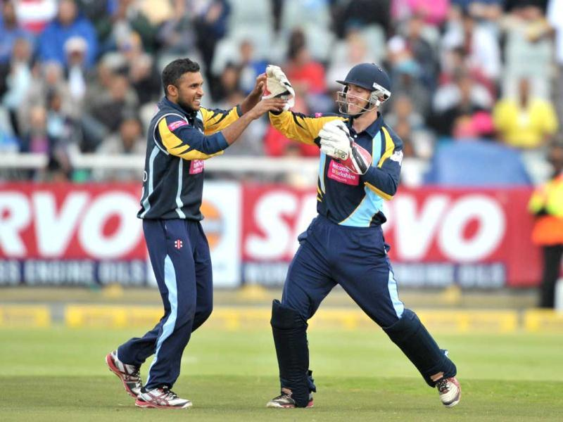 Adil Rashid of Yorkshire Carnegie celebrates with teammate Dan Hodgson after taking the wicket of Rohit Sharma of the Mumbai Indians during Match 11 of The Champions League T20 (CLT20) between the Mumbai Indians (India) and Yorkshire (England) at Newlands Cricket Stadium in Cape Town. AFP Photo/Luigi Bennett