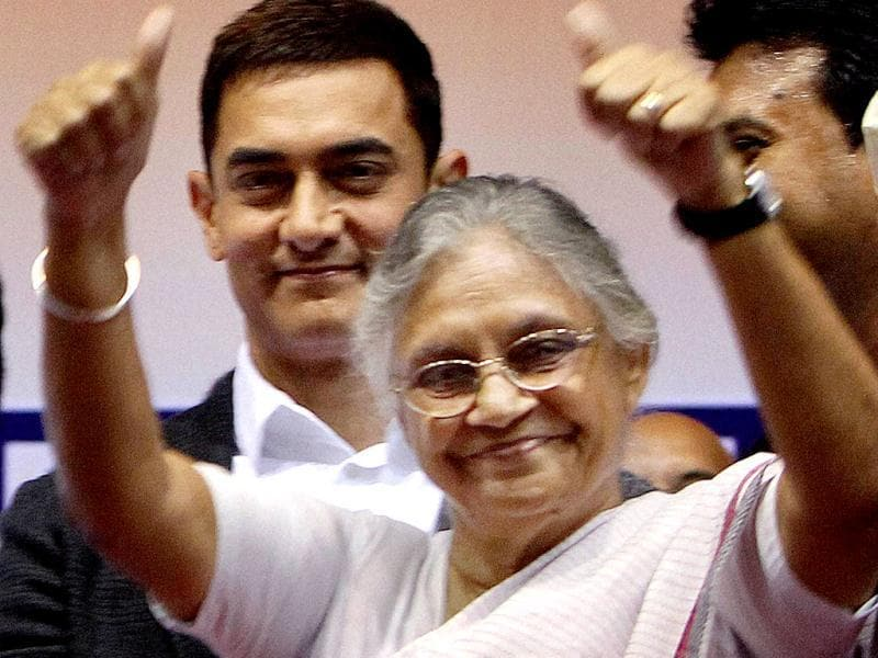 Delhi Chief Minister Sheila Dikshit gestures as actor Aamir Khan looks on at an award function. (PTI Photo)