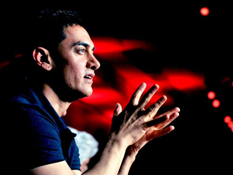 Bollywood actor Aamir Khan talks during the soundtrack launch for Talaash in Mumbai. (AFP)