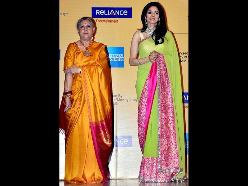 Bollywood actresses Sridevi (R) and Jaya Bachchan look beautiful as they pose at the opening ceremony of the 14th Mumbai Film Festival in Mumbai (AFP PHOTO)