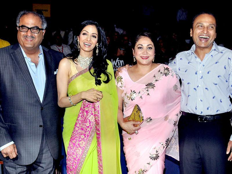 (L-R): Indian Bollywood director Boney Kapoor, actress Sridevi, socialite Tina Ambani and industrialist Anil Ambani pose as they attend the opening ceremony of the 14th Mumbai Film Festival in Mumbai late October 18, 2012. (AFP PHOTO)