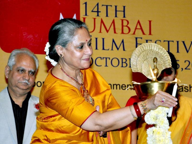 Jaya Bachchan lights a lamp at the opening ceremony for the 14th Mumbai Film Festival in Mumbai (AFP PHOTO)