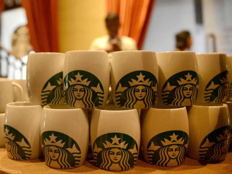 Starbucks Coffee mugs are on display at India's first newly-inaugurated Starbucks outlet in Mumbai. AFP/Punit Paranjpe