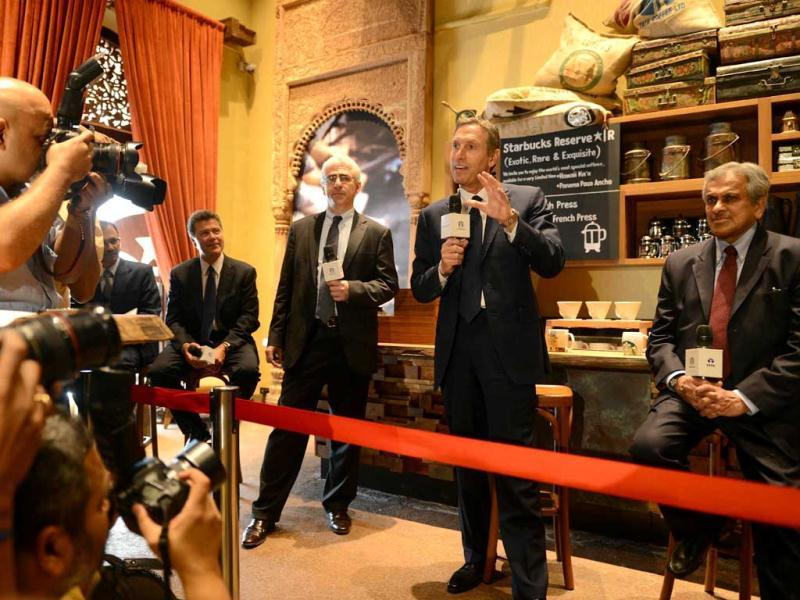 Starbucks Coffee Company's chairman Howard Schultz speaks as vice chairman of Tata Global Beverages RK Krishnakumar watches during a news conference at the country's first newly-inaugurated Starbucks outlet in Mumbai. AFP/Punit Paranjpe