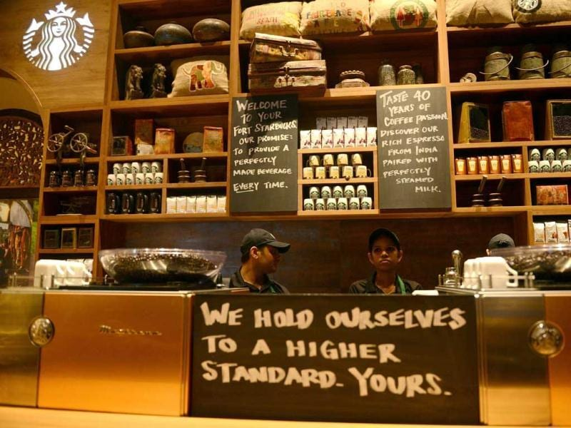 Staff are pictured behind the counter of India's first newly-inaugurated Starbucks outlet in Mumbai. AFP/Punit Paranjpe