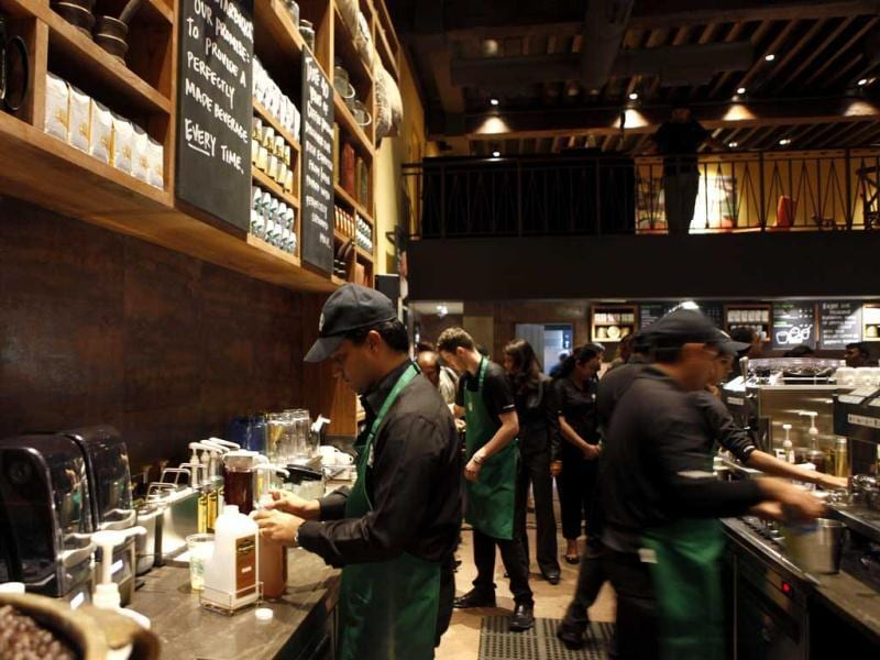 Employees of the newly inaugurated outlet of Starbucks work at a counter in Mumbai. Starbucks inaugurated its first store in India in a building in southern Mumbai as the Seattle-based coffee giant seeks growth in a market long associated with tea drinkers. AP/Rajanish Kakade