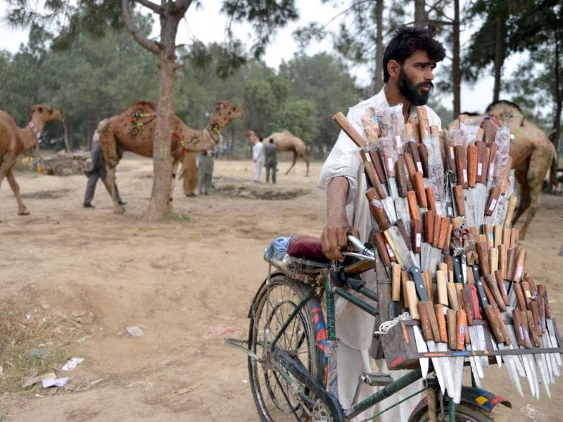A vendor sells knives at one of the main animal markets setup for the forthcoming Eid Al-Adha festival or the Feast of Sacrifice in Islamabad. AFP Photo