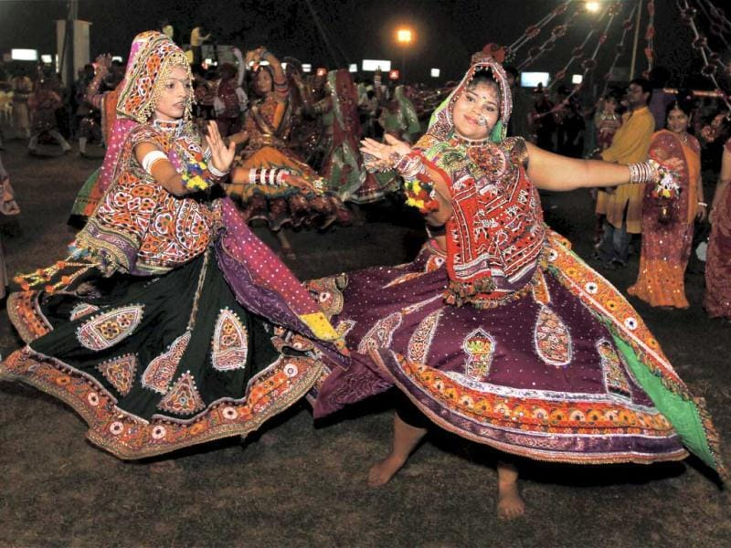 Youngsters take part in a Garba programme during Navratri festival in Ahmedabad. PTI Photo