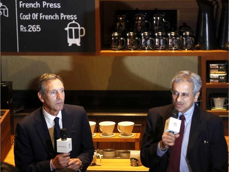 Starbucks Coffee's chairman Howard Schultz with Tata Global Beverages vice-chairman RK Krishnakumar at India's first Starbucks outlet inaugurated in Mumbai. HT/Vijayanand Gupta