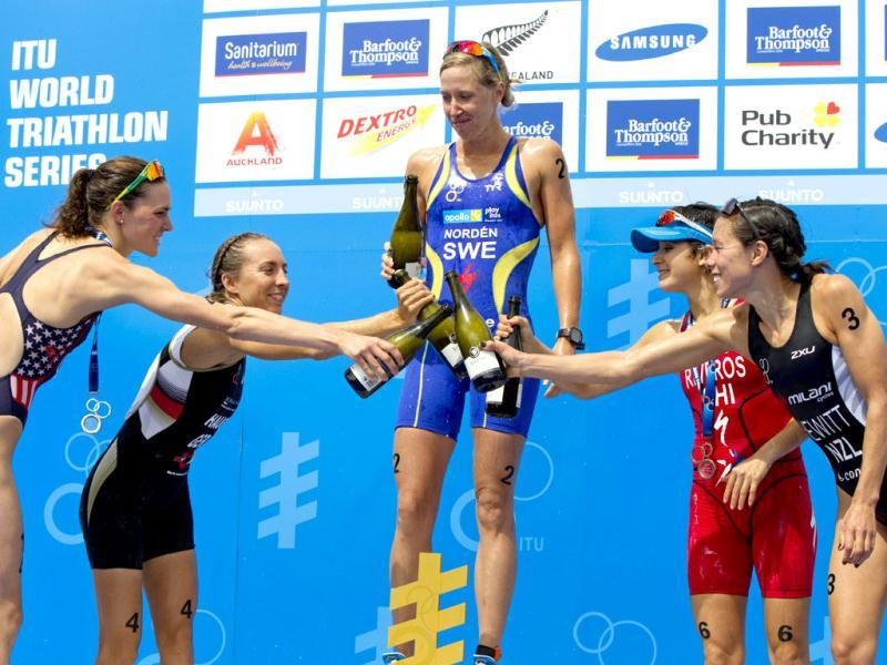 Championship winner Lisa Norden of Sweden celebrates with United States' Gwen Jorgensen, Germany's Anne Haug, Chile's Barbara Riveros Diaz, and New Zealand's Andrea Hewitt after taking the podium positions respectively in the elite women's race of the ITU World Triathlon Series grand final in Auckland, New Zealand. AP photo