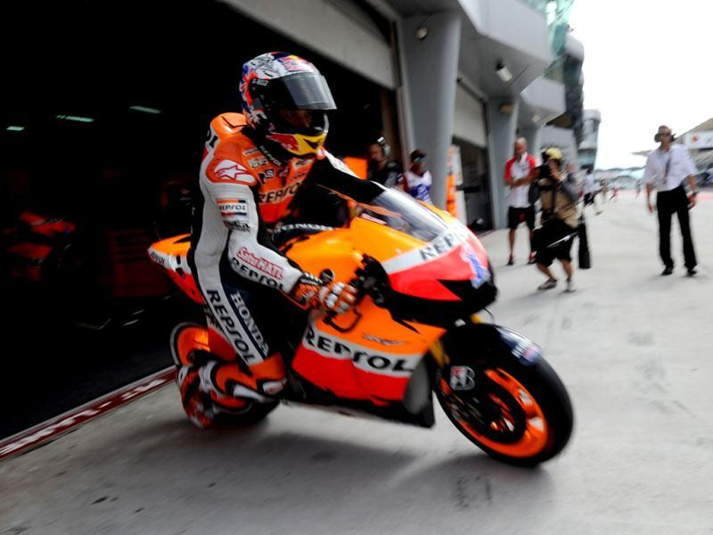 Honda rider Casey Stoner of Australia leaves his pit during the third practice session of the Malaysian Grand Prix MotoGP motorcycling race at Sepang circuit. AFP photo