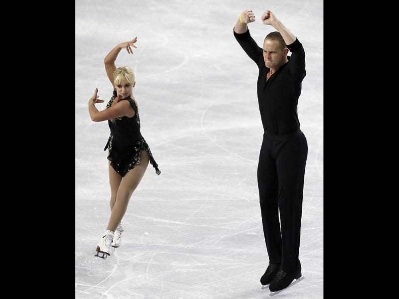 Caydee Denney and John Coughlin skate during the pairs short program in the Skate America figure skating event in Kent, Washington. AP photo
