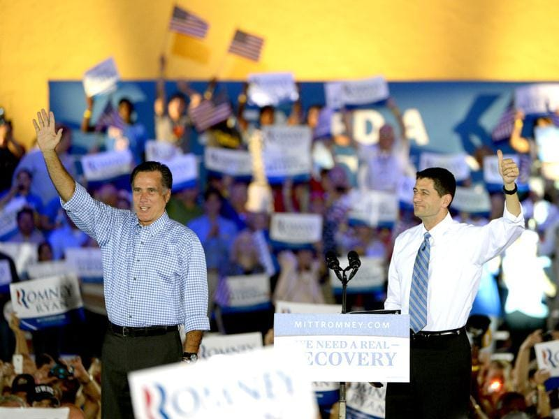 Republican presidential candidate Mitt Romney, left, and his vice presidential running mate Representative Paul Ryan wave to supporters after arriving on stage during the Romney Ryan Victory Rally in Daytona Beach, Florida. AP photo