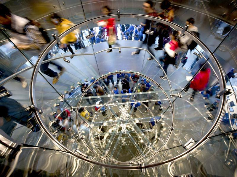 Chinese people walk spiral steps of a newly-opened Apple Store in Wangfujing shopping district in Beijing. AP Photo/Andy Wong