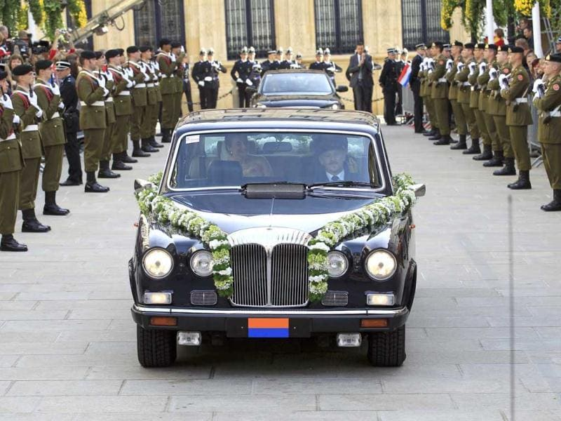 The car of Countess Stephanie de Lannoy leaves the Grand Ducal Palace on the way to the Notre-Dame Cathedral for her religious wedding with Luxembourg's Hereditary Grand Duke Guillaume in Luxembourg. Reuters Photo