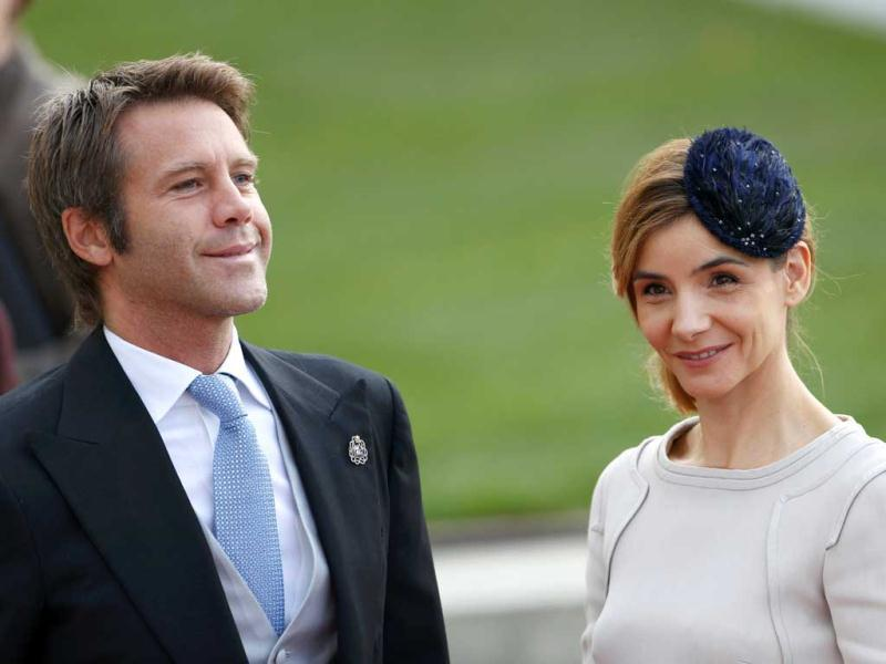 Prince Emanuele Filiberto of Savoy (L) and his wife French actress Clotilde Courau arrive for the religious wedding service of Luxembourg's Hereditary Grand Duke Guillaume and Countess Stephanie de Lannoy at the Notre-Dame Cathedral in Luxembourg. Reuters Photo