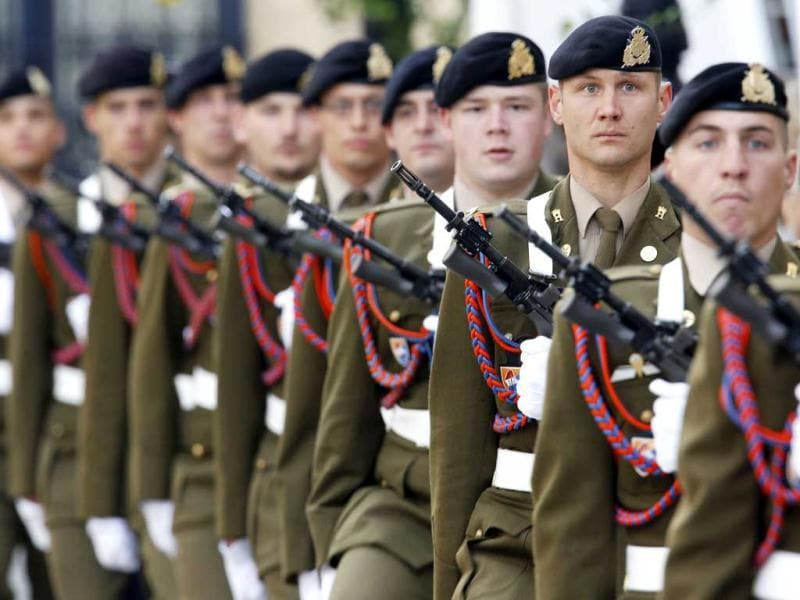 Soldiers stand guard near the Palace during the royal wedding in Luxembourg. AP Photo