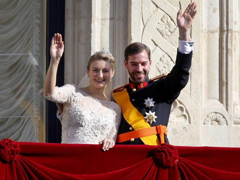 Luxembourg's Prince Guillaume and Countess Stephanie wave from the balcony of the Royal Palace after their wedding in Luxembourg. AP Photo