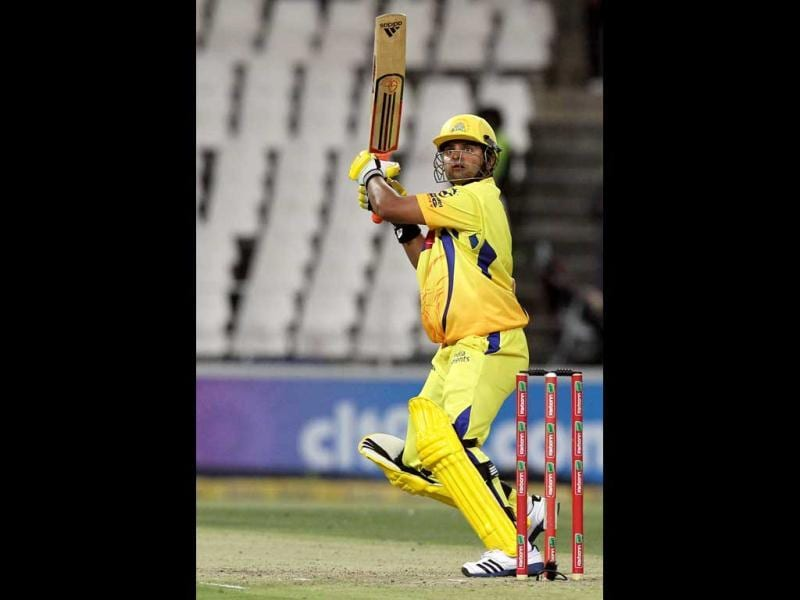 Chennai Supper Kings's batsman Suresh Raina watches his midair shot off Mumbai Indians bowler Lasith Malinga, unseen, during their Champions League Twenty20 cricket match at the Wanderers Stadium in Johannesburg. AP Photo/Themba Hadebe