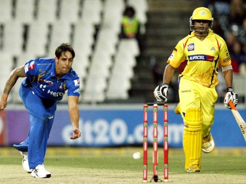 Mumbai Indians bowler Mitchell Johnson, left, throws the ball as he runs out Chennai Supper Kings's batsman Ravindra Jadeja, right, during their Champions League Twenty20 cricket match at the Wanderers Stadium in Johannesburg. AP Photo/Themba Hadebe