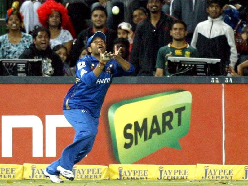 Mumbai Indians fielder Sachin Tendulkar takes a catch to dismiss Chennai Supper Kings's batsman Albie Morkel, unseen, during their Champions League Twenty20 cricket match at the Wanderers Stadium in Johannesburg. AP Photo/Themba Hadebe