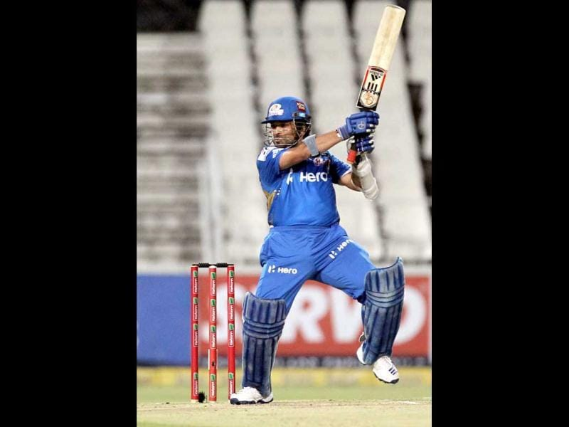 Mumbai Indians batsman Sachin Tendulkar takes a shot during their Champions League Twenty20 cricket match against Chennai Super Kings at the Wanderers Stadium in Johannesburg. AP Photo/Themba Hadebe
