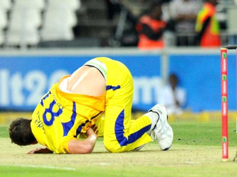Chennal Super Kings bowler Albie Morkel falls during a Group B Champions League T20 (CLT20) match against Mumbai Indians at Wanderers Stadium in Johannesburg. AFP Photo/Alexander Joe