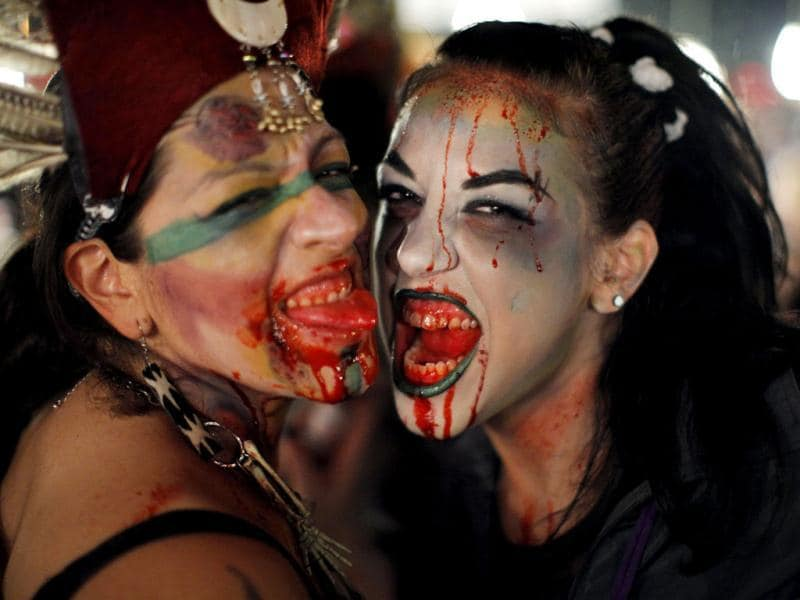 Women dressed up as zombies pose for a picture during an event in New York. Hundreds of people took part in the event known as