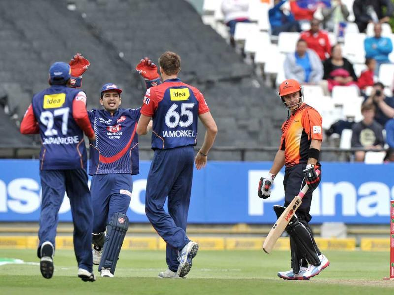 Wicketkeeper Naman Ojha of the Daredevils celebrates with teammate Morne Morkel after taking the wicket of Herschelle Gibbs of the Scorchers during Match 15 of The Champions League T20 (CLT20) between the Perth Scorchers and Delhi Daredevils at Newlands Cricket Stadium in Cape Town. AFP Photo/STR