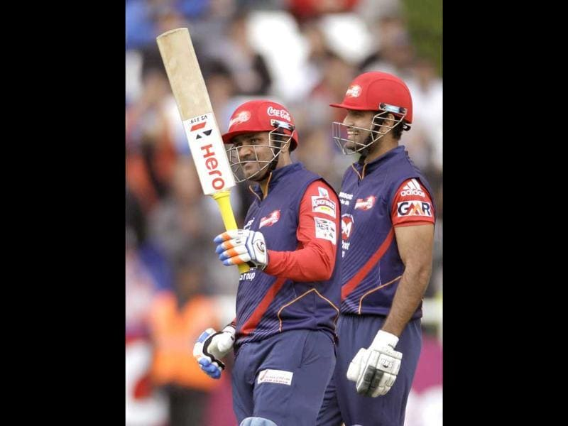 Delhi Daredevils Virender Sehwag holds his bat up as he makes over fifty runs against Perth Scorchers during a Champions League Twenty20 game in Cape Town. AP Photo/Schalk van Zuydam