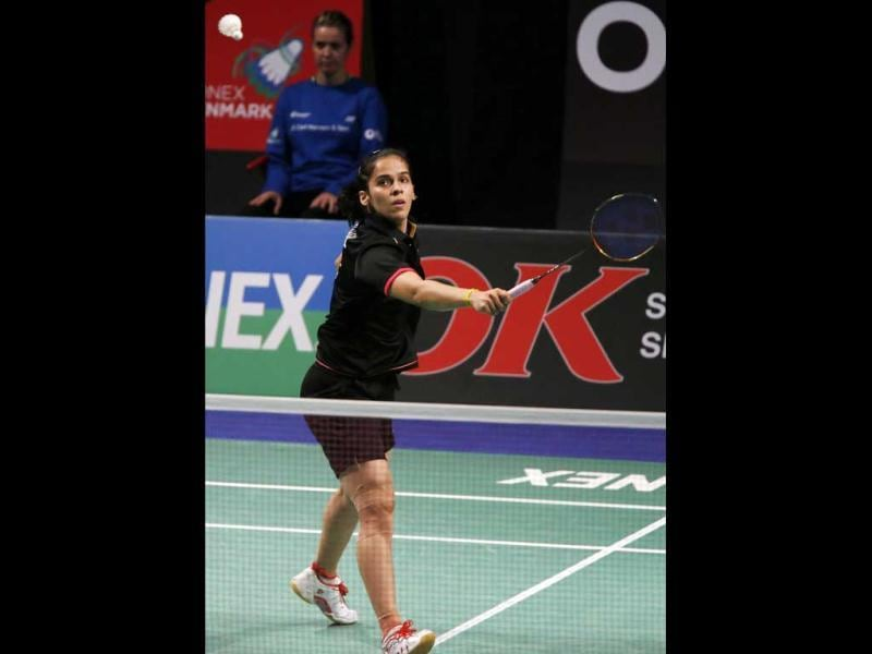 Saina Nehwal competes during the Denmark Open woman's single final badminton match against Juliane Schenk of Germany in Odense, Denmark. 2012. AP Photo