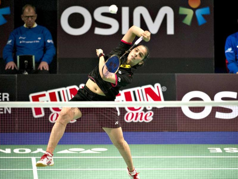 Saina Nehwal returns to Juliane Schenk of Germany during their women's singles final match at the Danish Open badminton championship in Odense, Denmark. AFP Photo