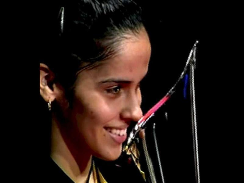 Saina Nehwal holds the trophy after winning the Denmark Open woman's single final badminton match against Juliane Schenk of Germany in Odense, Denmark. PTI Photo