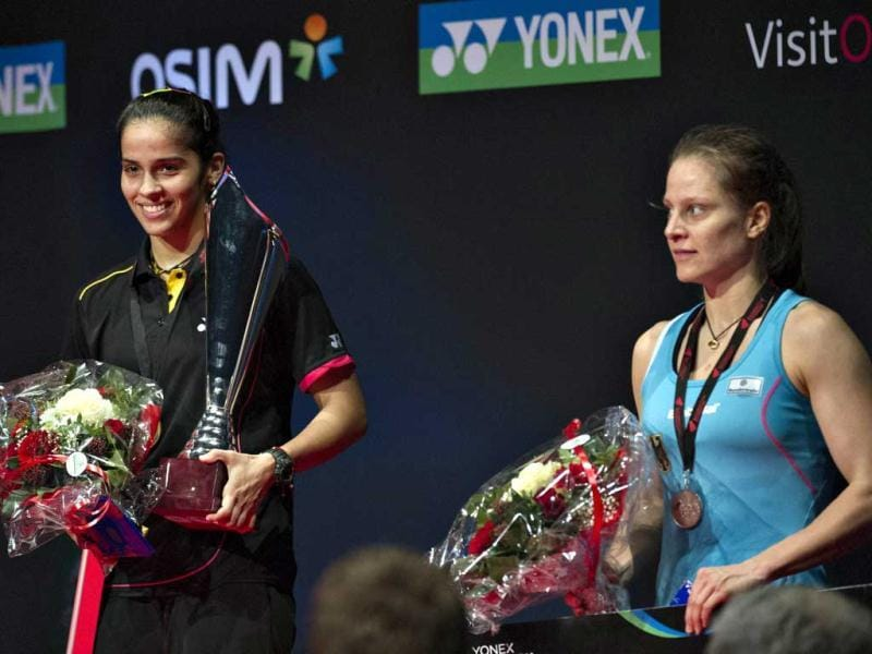 Saina Nehwal poses with the trophy after her victory against Juliane Schenk of Germany during their women's singles final match at the Danish Open badminton championship in Odense, Denmark. AFP Photo