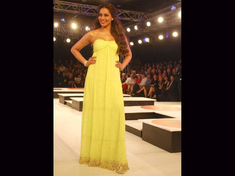 Bipasha Basu looked beautiful as she walked the ramp in a lime green gown with a gold-sequinned border.