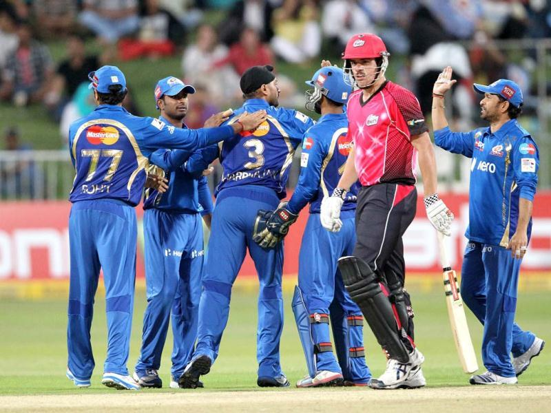 Moise Henriques of the Sydney Sixers walks off as the Mumbai Indians celebrate his wicket during a Champions League T20 (CLT20) match Sydney Sixers vs Mumbai Indians at Sahara Stadium Kingsmead in Durban. AFP Photo