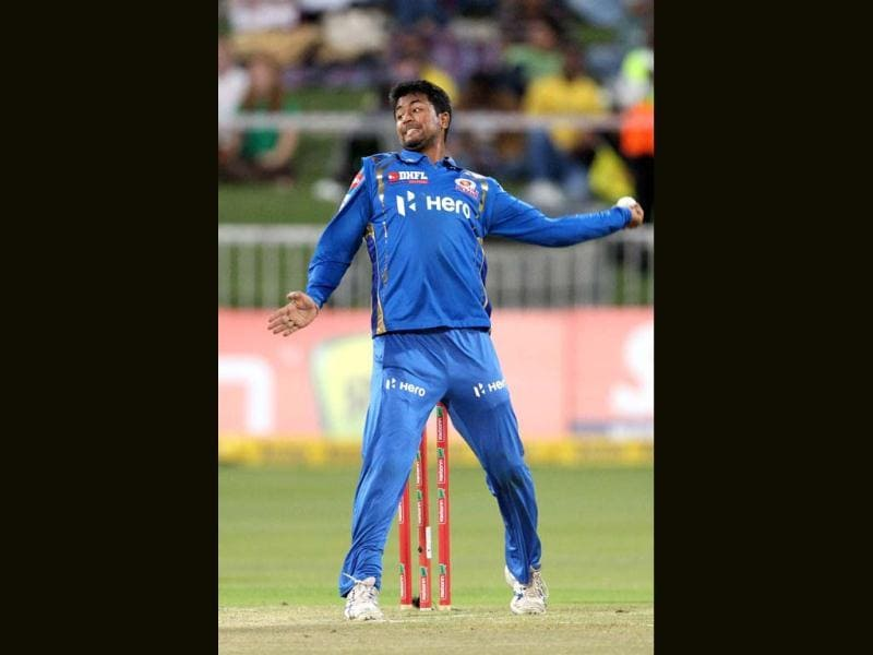 Pragyan Ojha of the Mumbai Indians bowls on during a Champions League T20 (CLT20) match Sydney Sixers vs Mumbai Indians at Sahara Stadium Kingsmead in Durban. AFP Photo