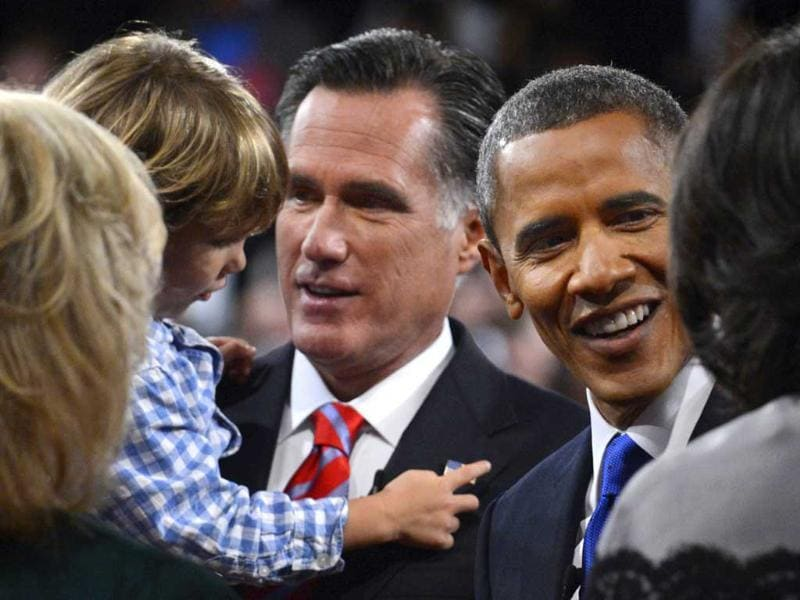President Barack Obama and Republican presidential nominee Mitt Romney meet family members after the third presidential debate at Lynn University, in Boca Raton, Fla. (AP Photo/Pool-Michael Reynolds)
