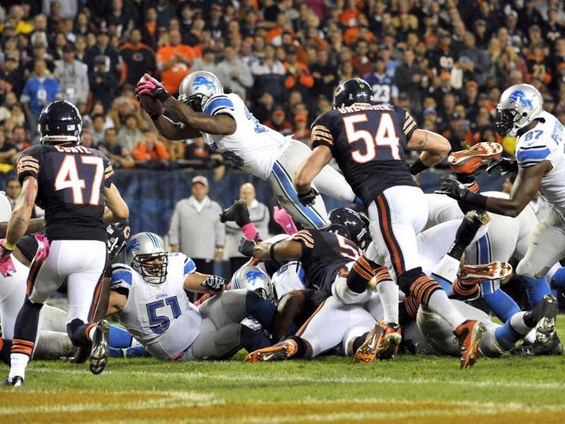 Joique Bell #35 of the Detroit Lions ties to dive into the end zone instead he fumbled the ball against the Chicago Bears at Soldier Field in Chicago, Illinois. David Banks/Getty Images/AFP
