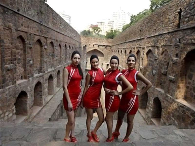 Indian Formula One grid girls pose at a photocall ahead of the Indian Formula One Grand Prix, in New Delhi. AP Photo/Altaf Qadri