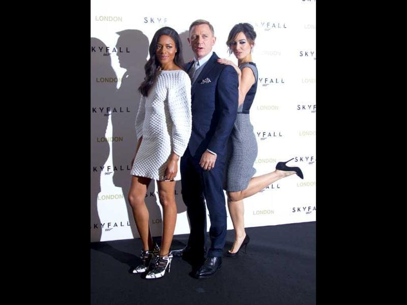 Bond with his girls: Naomie Harris (L) and Berenice Marlohe (R) pose with Mr Bond Daniel Craig.