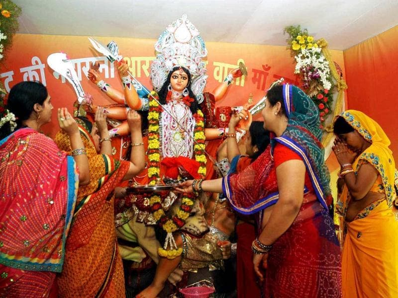 Devotees performing Durga Pooja on the ninth day of Durga Puja in Bangalore. (Agencies)