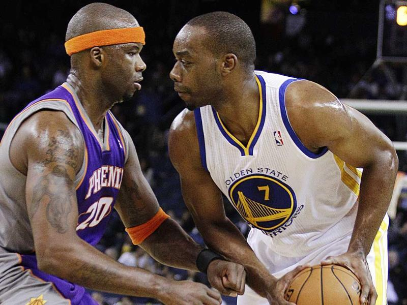Phoenix Suns' Jermaine O'Neal, left, defends against Golden State Warriors' Carl Landry during the second half of an NBA preseason basketball game in Oakland, California. AP Photo