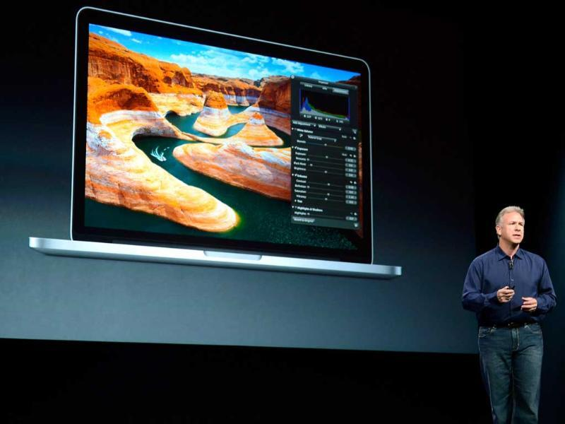 Apple Senior Vice President of Worldwide product marketing Phil Schiller announces the new 13-inch MacBook Pro during an Apple special event at the historic California Theaterin San Jose, California. Apple is expected to introduce a smaller, less expensive version of the iPad. Getty Images/AFP