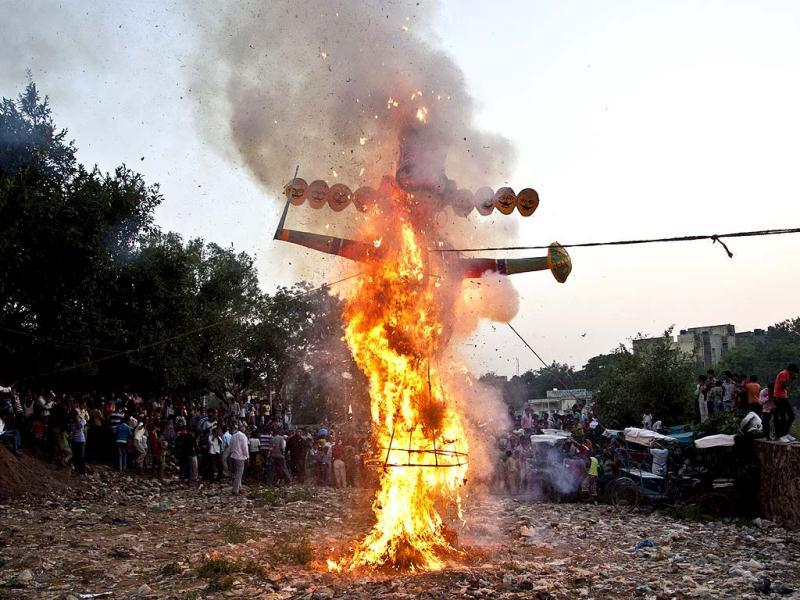 An effigy of demon king Ravan goes up in flames during Dussehra celebrations in New Delhi. AP Photo/Tsering Topgyal