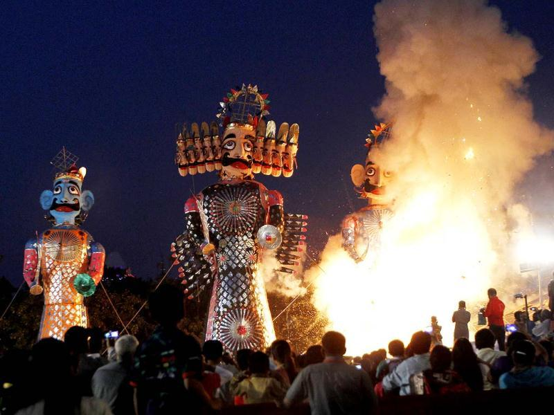 The effigies of demon king Ravan, Meghnad and Kumbhakarna burn during Dussehra celebration at Shri Dharmic Leela Committee at Parade Ground, in Old Delhi. HT Photo/Ajay Aggarwal