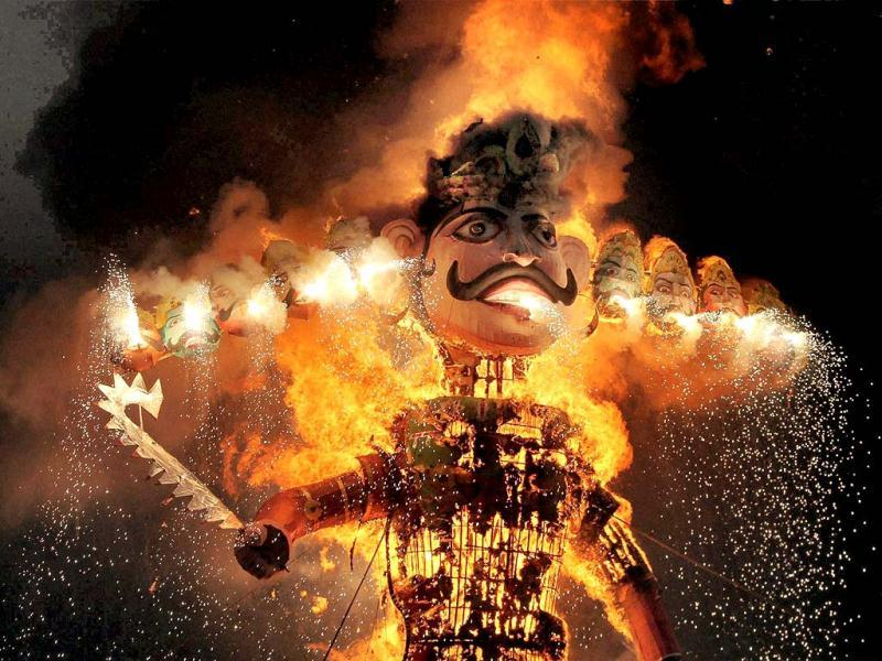 The effigy of demon king Ravan burns during Dussehra celebrations in Faridabad. PTI Photo