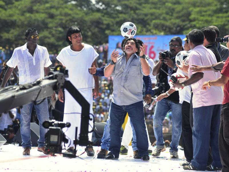 Argentine soccer legend Diego Maradona, center, entertains fans in Kannur, Kerala. Maradona arrived on a two-day private visit. (AP Photo)